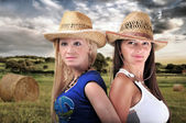 Two Girls Wearing cowboy Hats And Smiling — Foto Stock