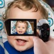 Baby boy to camcorder — Stock Photo #3937872