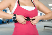 Checking pulse watch — Stockfoto