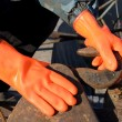 Orange gloves — Stock Photo