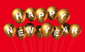 Gold happy new year balloons — Stock Photo