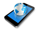 Mobile phone and world globe — Stock Photo