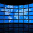 Video wall of flat tv screens with world map - Stock Photo