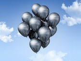 Silver balloons on a blue sky — Stock Photo