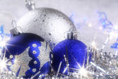 Christmas card with blue and silver ornaments — Stock Photo
