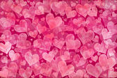 Pink hearts background — Stock Photo