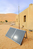 Solar panel with desert house — Stock Photo