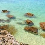 Sea cave and rocks on coastline of beach of sea — Stock Photo #4125608