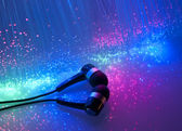 Headphone with fiber optical background — Stock Photo