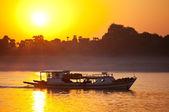 Boat on sunset — Stock Photo