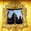 Stock Photo: Gold decor on window