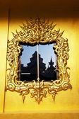 Gold decor on window — Stock Photo