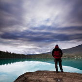 Man on the lake — Stock Photo