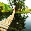 Bridge on small river — Stock Photo