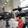 Videocamera and journalists — Stock Photo