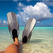 Feet in flippers at the beach - Stock Photo