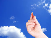 Hand and sky — Stock Photo