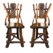 图库照片: Old antique wooden handwork chairs isolated over white