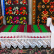 Stockfoto: Antique wooden handmade bed and carpets