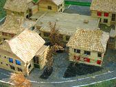 Decorative village breadboard wooden house models — Stock Photo