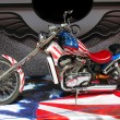 Stock Photo: Chopper motorbike on americflag background