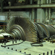 Steam turbine during repair, machinery, pipes, tubes at a power - Stock Photo
