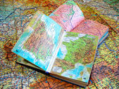 Two opened old atlas book on the spread map — Stock Photo
