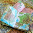 Постер, плакат: Two opened old atlas book on the spread map