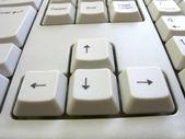 Vier pijltoetsen op een toetsenbord van de computer — Stockfoto