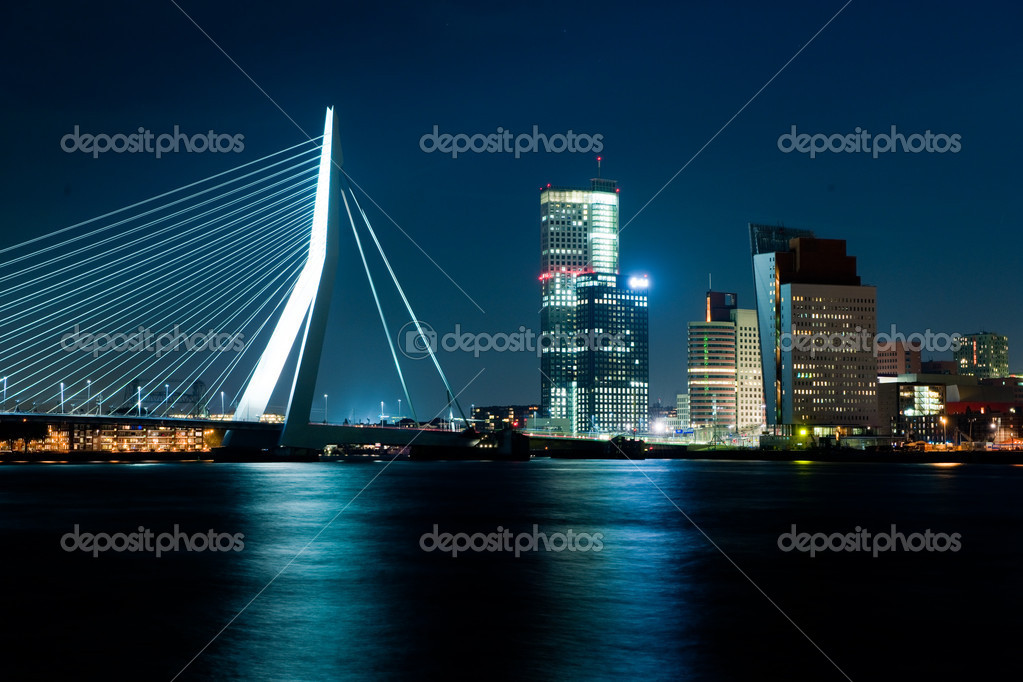 The illuminated Skyline of Rotterdam, Netherlands at night  Stock Photo #4878710