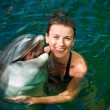Stock Photo: Girl and dolphin