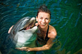 Girl and dolphin — Stock Photo