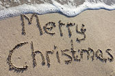 Merry Christmas written on the sand — Stock Photo