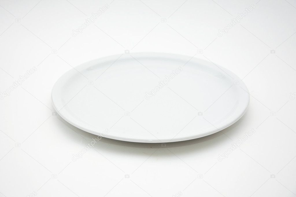 White empty plate over a white background.  Stock Photo #3946673