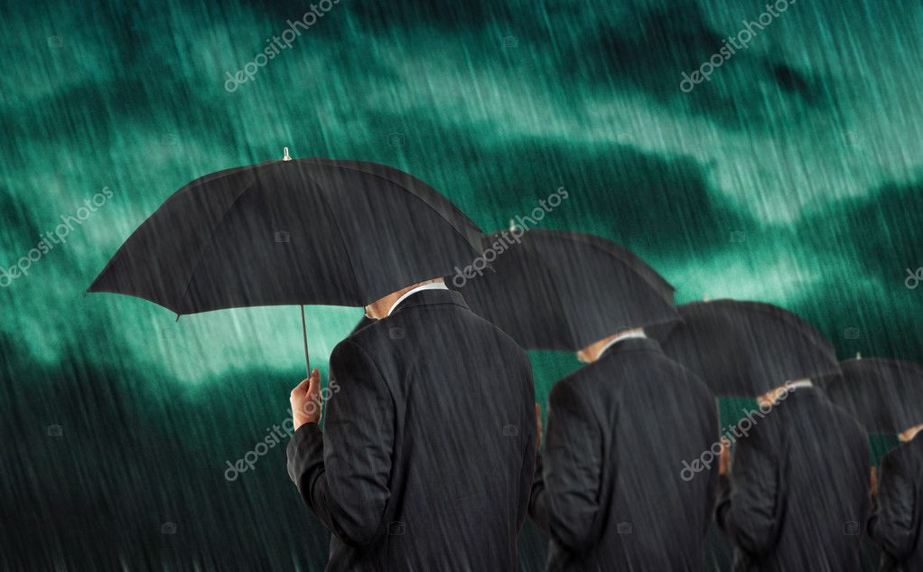 Businessman with umbrellas in heavy rain. — Stock Photo #3952595