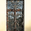 Openwork metal grille on the window - Stock Photo