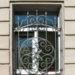 Openwork metal grille on window — Stock Photo #4677324