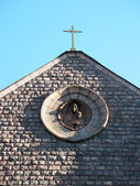 Catholic church of Our Lady of Lourdes. A fragment of the facade. St. Peter — Stock Photo