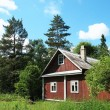 Stock Photo: Wooden house in the woods