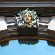 Bronze sculpture on the facade of the House Books - the former building of — Stock Photo #5169447