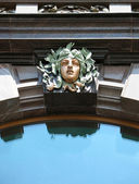 Bronze sculpture on the facade of the House Books - the former building of — Stock Photo