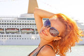 Smiling woman and cruise ship on background — Stock Photo