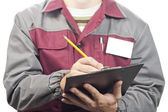 Service man with clipboard — Stock Photo