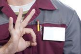 Name tag on uniform and OK sign — Stock Photo