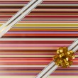 Ribbon and bow on color gift paper — Stockfoto