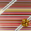 Ribbon and bow on color gift paper — Stock Photo