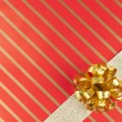 Gold ribbon and bow — Stock Photo