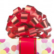 Gift with big red bow and ribbon - ストック写真