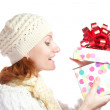 Happy smiling woman opening christmas gift — Stock Photo