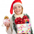Happy smiling woman in christmas hat with gifts — Stock Photo